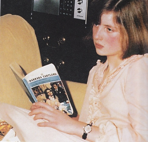 A young Diana reading a romance by her grandmother, Barbara Cartland