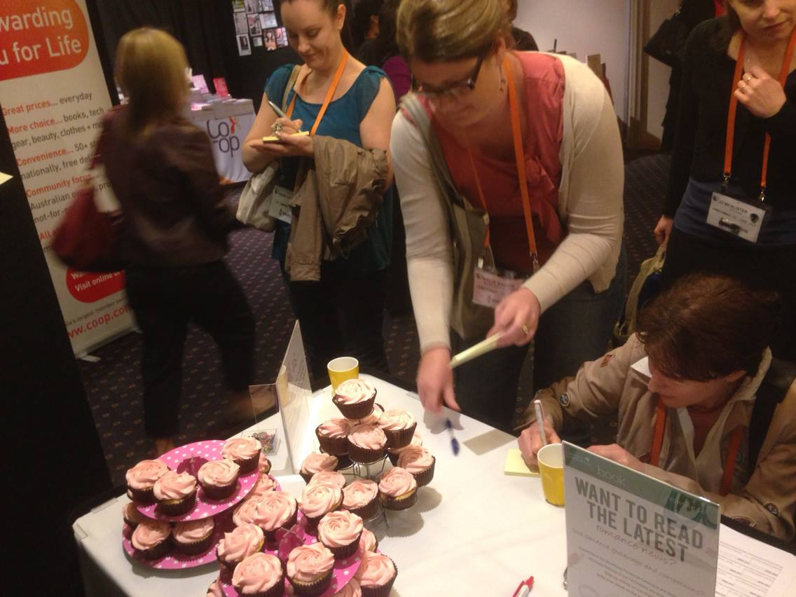 Bribing women with cupcakes to write why they love romance.