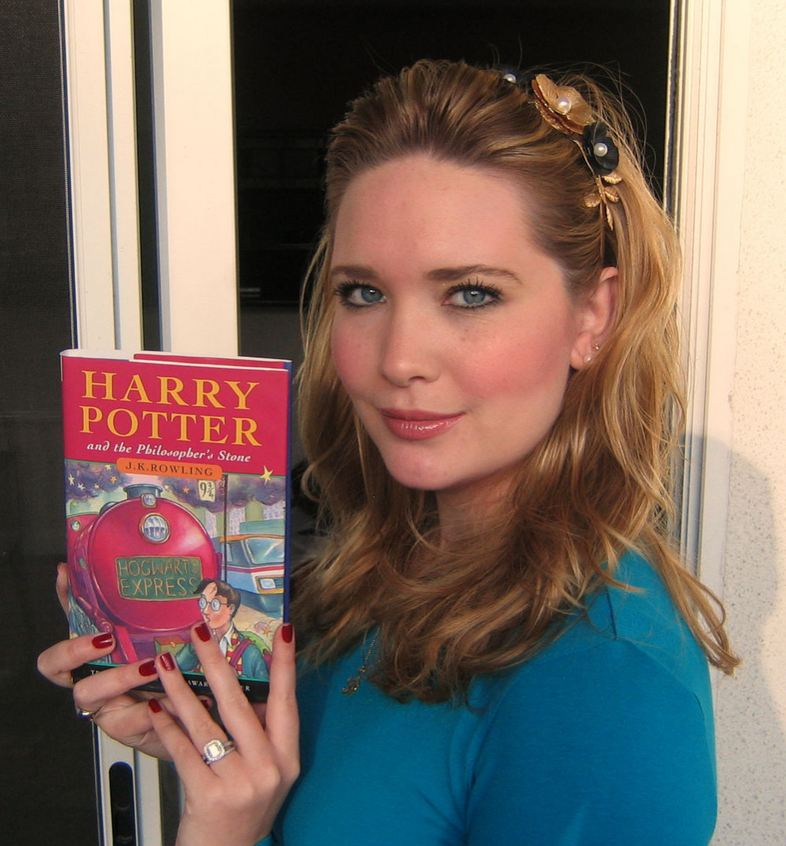 Sarah J. Maas with her first every copy of Harry Potter and the Philosopher's Stone.